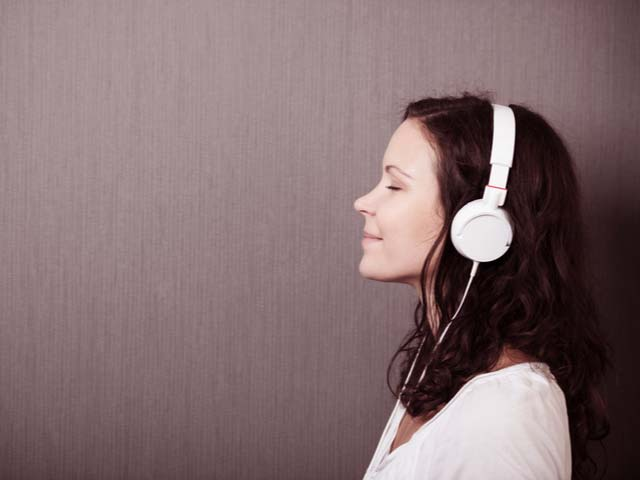 woman listening to guided imagery recording to stop being insecure in her relationship