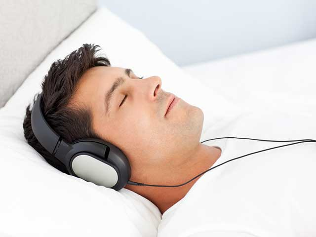 Man listening to guided imagery for performance anxiety and erectile dysfunction