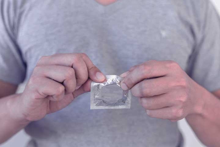 Man afraid to lose his erection when putting on a condom