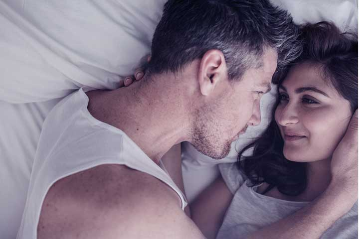 Couple in bed after using home remedies for premature ejaculation