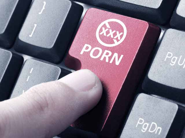 an image of a premature ejaculation typing porn on a keyboard