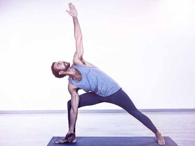 A man practicing a yoga pose for premature ejaculation