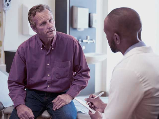 A man consulting with a doctor about having a vasectomy