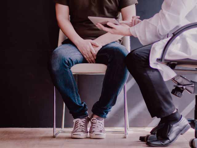 A man consulting with a doctor about prostatitis and premature ejaculation