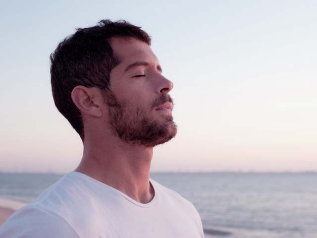 Man practicing deep breathing exercises for erectile dysfunction